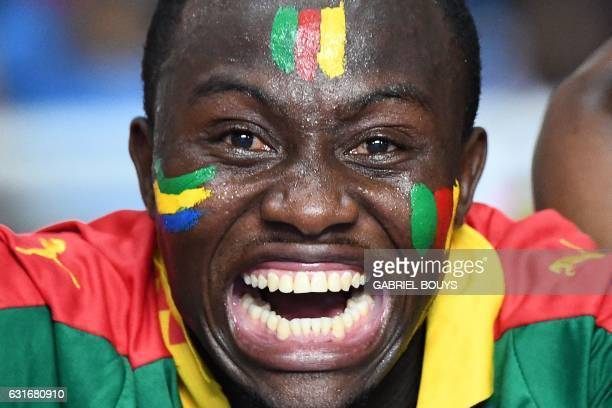 A Cameroon supporter reacts during the 2017 Africa Cup of Nations group A football match between Burkina Faso and Cameroon at the Stade de l'Amitie...