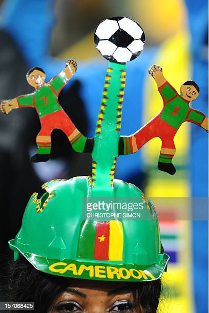A Cameroon supporter wearing a Makarapa waits for the start of the Group E first round 2010 World Cup football match Cameroon vs Denmark on June 19...