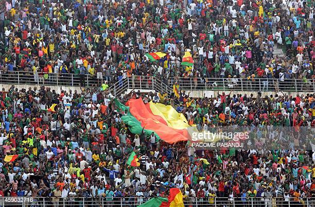 Cameroon supporters cheer their team during the 2015 African Cup of Nations qualifier group D football match Cameroon vs DR Congo at the Ahmadou...