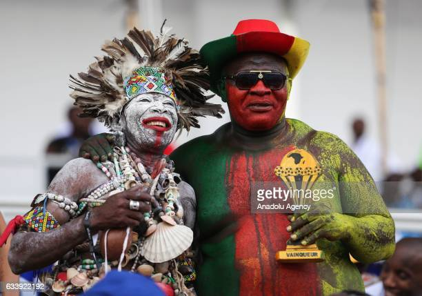 Cameroon supporters pose for a photo ahead of the 2017 Africa Cup of Nations final football match between Egypt and Cameroon at the Stade de l'Amitie...