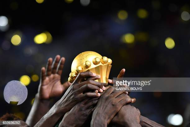 Cameroon team players hold up the winner's trophy as they celebrate beating Egypt 21 to win the 2017 Africa Cup of Nations final football match...