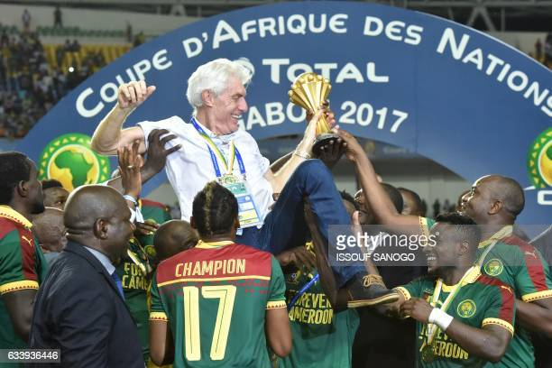 Cameroon team players lift Cameroon's Belgian coach Hugo Broos as the celebrate after beating Egypt 21 to win the 2017 Africa Cup of Nations final...