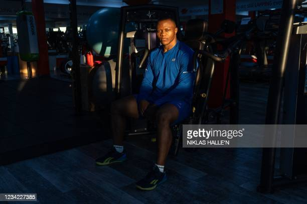 Cameroon-born Cyrille Tchatchet II poses for a photograph as he trains in a gym at Middlesex University in Hendon, north London on July 8, 2021 ahead...