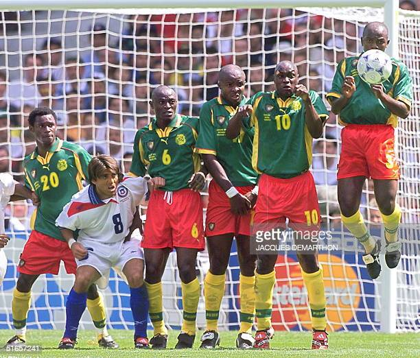 Cameroonese Salomon Olembe Pierre Njanka Michel Pensee Patrick Mboma and Pierre Wome watch the ball pass by to score a goal after a free kick by...