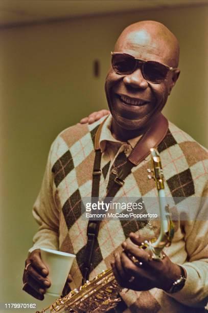 Cameroonian afrobeat musician Manu Dibango posed with saxophone in London circa 2000