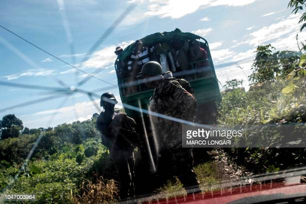 TOPSHOT Cameroonian army soldiers secure the perimeter of a polling station in Lysoka near Buea southwestern Cameroon on October 7 2018 during...