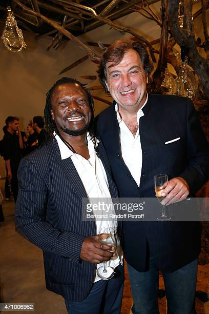 Cameroonian artist Pascale Marthine Tayou who exhibited at the Gallery and Alexandre Vilgrain attend the 'A Moment of Reconstruction' Informal Dinner...
