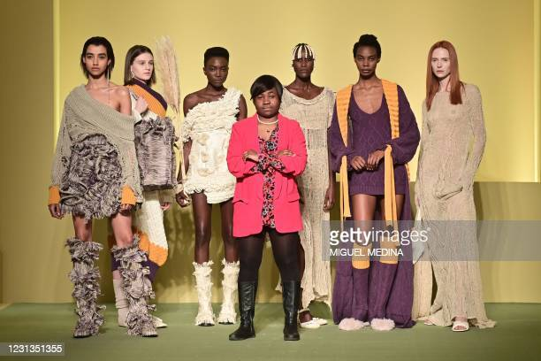 """Cameroonian fashion stylist Claudia Gisele Ntsama from the collective """"Black Lives Matter in Italian Fashion"""" poses with her models on February 17,..."""