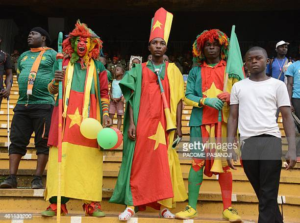 Cameroonian football supporters dressed in the colours of the national flag are seen at the start of the friendly match Cameroon vs DR Congo in...