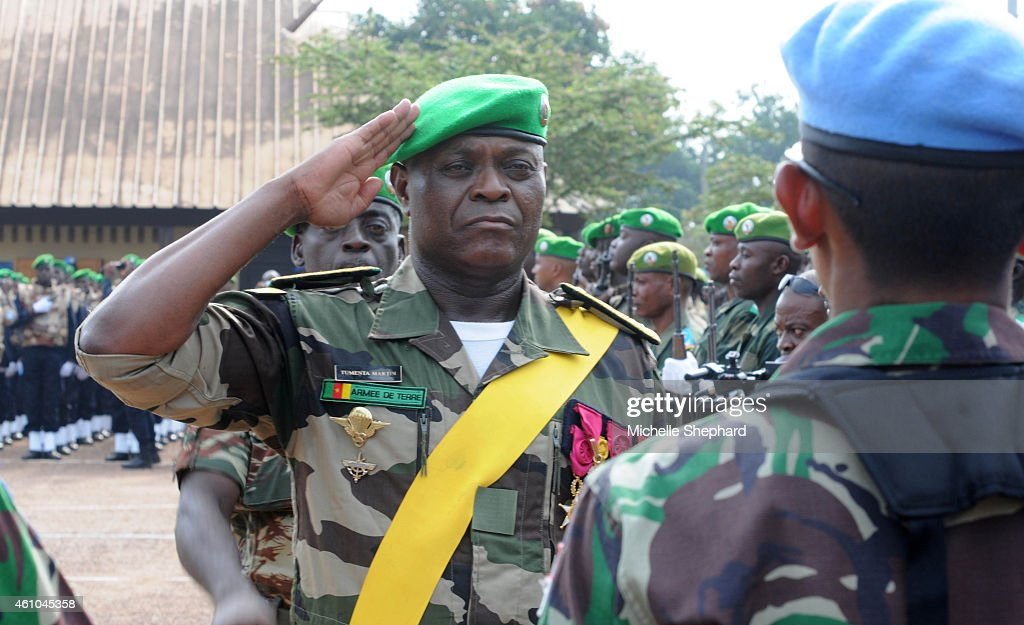 Cameroonian General Martin Tumenta at the Sept. 14, 2014 're-hat' ceremony where he trades his African Union beret for the blue of the United Nations, which took over the peacekeeping mission.