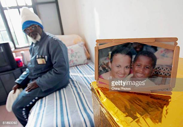 A Cameroonian inmate of the Shanghai Qingpu Prison sits in his room before an evening held by the prison to celebrate Christmas on December 24 2004...