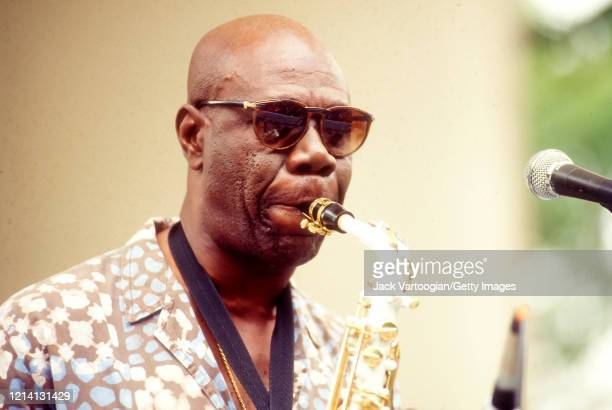 Cameroonian Makossa musician and bandleader Manu Dibango plays alto saxophone with his band as he performs onstage at Central Park SummerStage New...