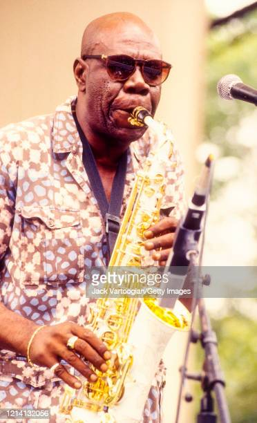 Cameroonian Makossa musician and bandleader Manu Dibango plays alto saxophone with his band as he performs onstage at Central Park SummerStage, New...