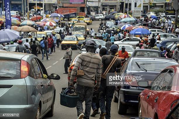Cameroonian men working as shoe shiners look for customers on April 27 2015 in Yaounde The recent deaths of hundreds of migrants has not discouraged...