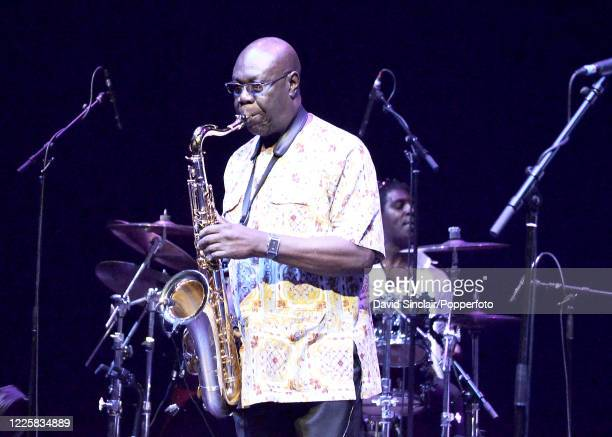 Cameroonian musician Manu Dibango performs live on stage at The Barbican in London on 26th November 2013.