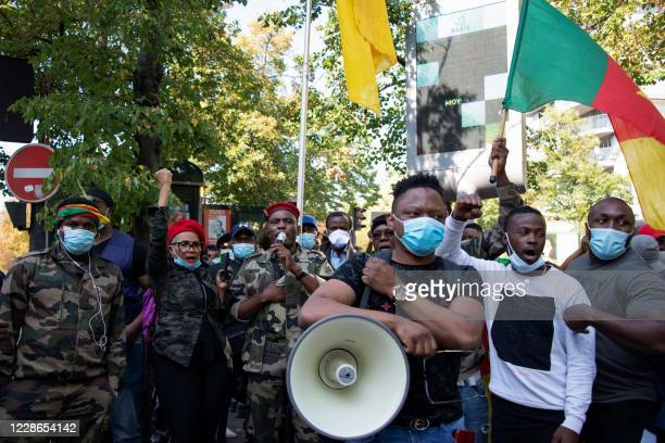 Cameroonian opponents of current Cameroonian president shout slogans during a demonstration against Cameroon's President Paul Biya near the embassy...