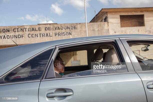 Cameroonian opposition leader Maurice Kamto sits in the back of a car as he is driven away on October 5 the day of his release from prison in Yaounde...