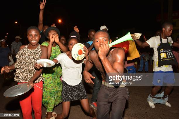 Cameroonian people celebrate after a late goal by Vincent Aboubakar sealed a 21 championship win for Cameroon over Egypt in the Africa Cup of Nations...