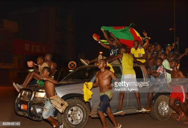 Cameroonian people celebrate after a late goal by Vincent Aboubakar sealed a 2-1 championship win for Cameroon over Egypt in the Africa Cup of...