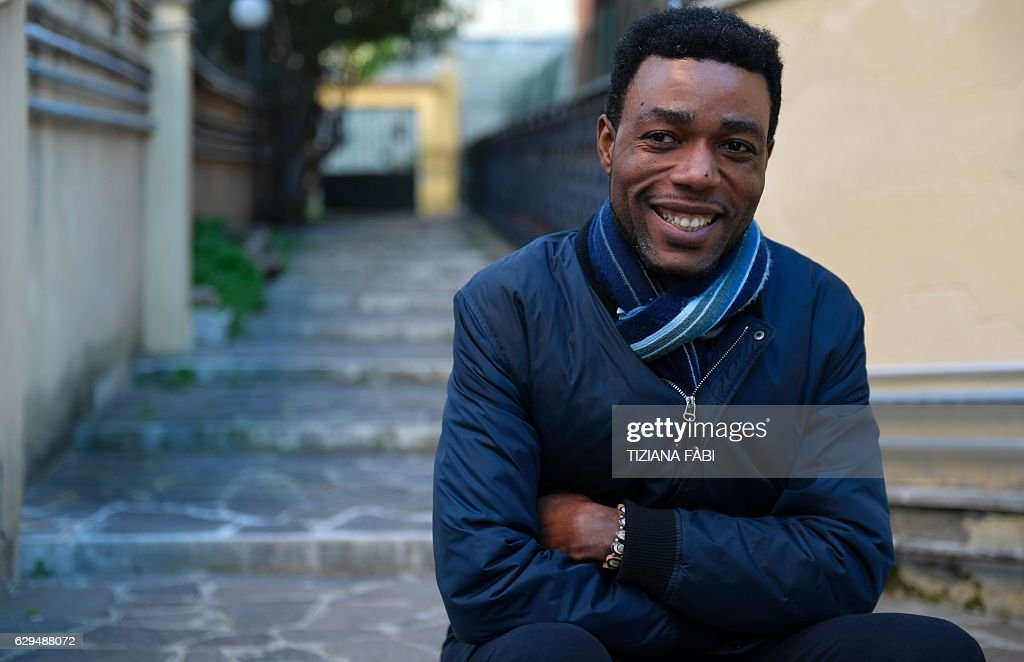 IOVENE - Cameroonian Pierre Yvan Sagnet, 31, poses on November 30, 2016 during an interview in Rome. Pierre Yvan Sagnet was elevated 'Knight of the Order of Merit of the Italian Republic' by Italy's President Sergio Mattarella for having rebelled against the exploitation of migrant workers in southern Italy. / AFP / TIZIANA