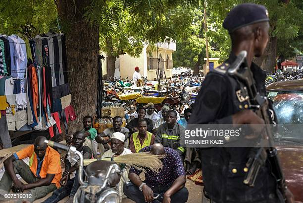 A Cameroonian policeman patrols as Muslims attend the Friday prayer in Maroua in the extreme northern province west of the Nigerian border on...