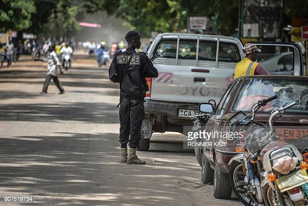 A Cameroonian policeman patrols in Maroua in the extreme northern province west of the Nigerian border on September 16 2016 / AFP / REINNIER KAZE