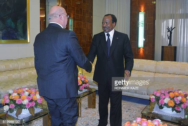 Cameroonian President Paul Biya shakes hands with French Finance minister Michel Sapin before a meeting at the Presidential Palace in Yaounde on...