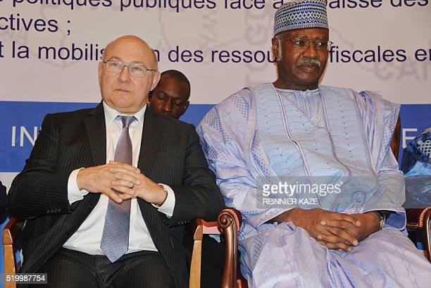 Cameroonian Prime Minister Philemon Yang and French Finance minister Michel Sapin attend a conference in Yaounde on April 9 2016 Sapin joined fifteen...