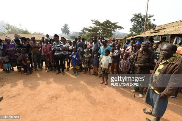 Cameroonian refugees including women and children gather for a meeting at BashuOkpambe village in Boki district of Cross Rivers State in Nigeria on...