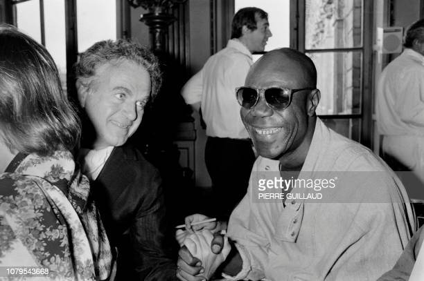 Cameroonian saxophone player Manu Dibango jokes with French singer Guy Béart during the Victoires de la Musique the annual French music awards...