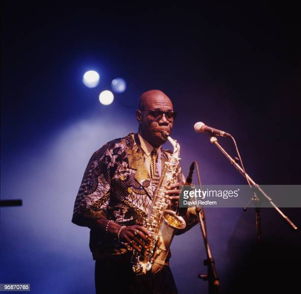 Cameroonian saxophonist Manu Dibango performs on stage circa 2000.