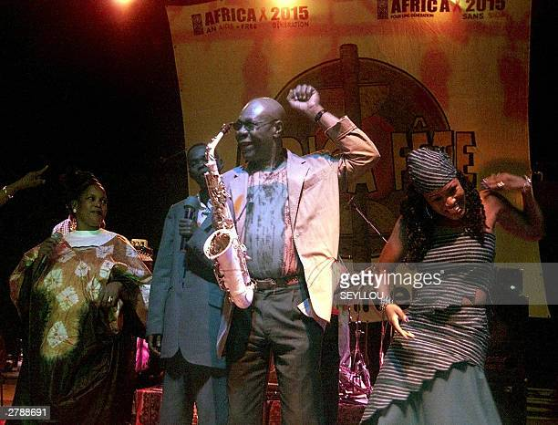Cameroonian saxophonist Manu Dibango performs with musicians Baba Maal of Senegal Guinean Kande Kante and Malian Molobaly Traore 05 December 2003 in...