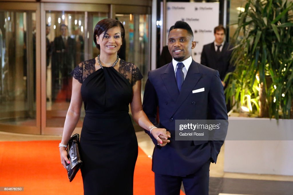 Cameroonian soccer player Samuel Eto'o and his wife Georgette Eto'o pose for pictures on the red carpet during Lionel Messi and Antonela Rocuzzo's Wedding at City Center Hotel on June 30, 2017 in Rosario, Argentina.