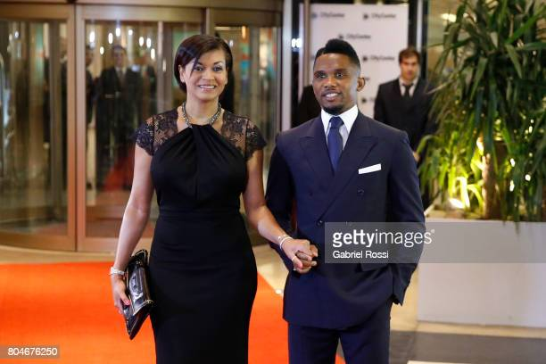 Cameroonian soccer player Samuel Eto'o and his wife Georgette Eto'o pose for pictures on the red carpet during Lionel Messi and Antonela Rocuzzo's...