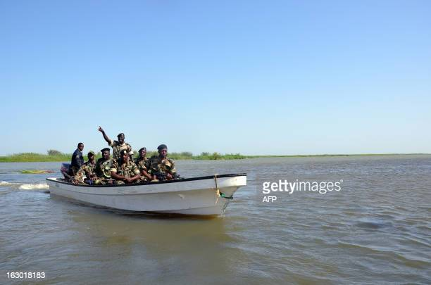 Cameroonian soldiers patrol Lake Chad on March 1 2013 near Darak close to the Nigerian border Several security sources believe it is likely that...