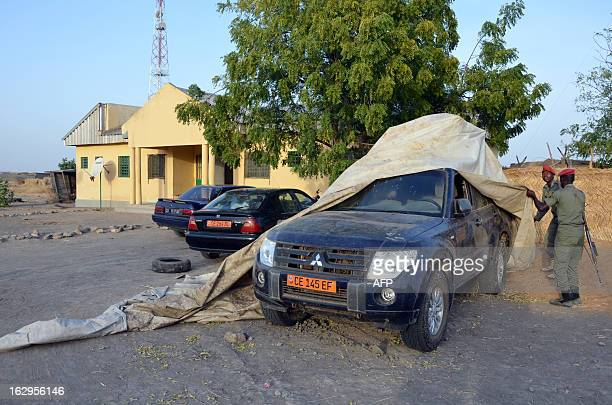 Cameroonian soldiers remove on February 28 2013 in Dabanda the tarp from the car of the French family that was kidnapped on February 19 in a nearby...