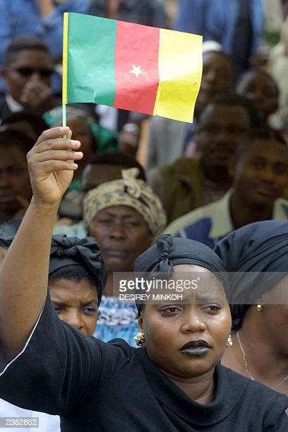 A Cameroonian woman hold a Cameroon flag outside the sporting complex in Biteng where Cameroonian football player MarcVivien Foe's coffin is being...