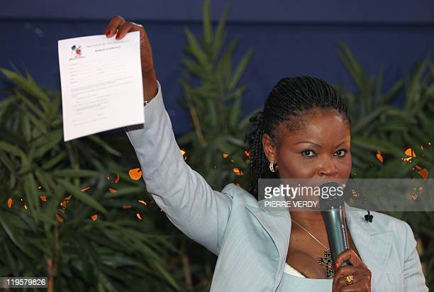 Cameroonian writer Calixthe Beyala President of the Mouvement des Africains holds a document during a debate on July 16 2011 in Paris where a video...