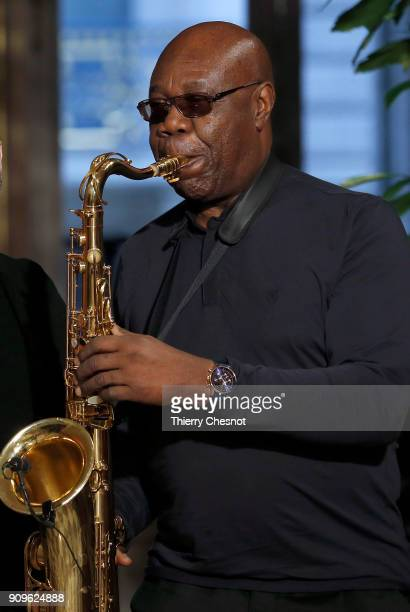Cameroonian-French saxophonist Manu Dibango performs at the end of the Franck Sorbier Spring Summer 2018 show as part of Paris Fashion Week on...