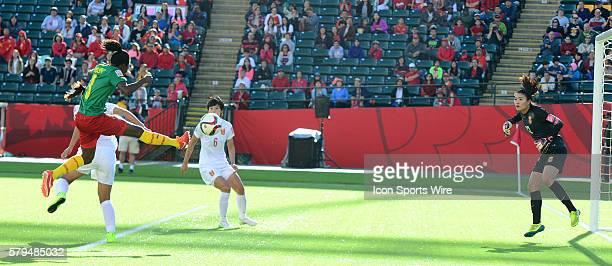 Cameroon's Ajara Nchout flies in the air to kick the ball toward China's goalkeeper Wang Fei as FEi makes the save at the FIFA Womens World Cup at...