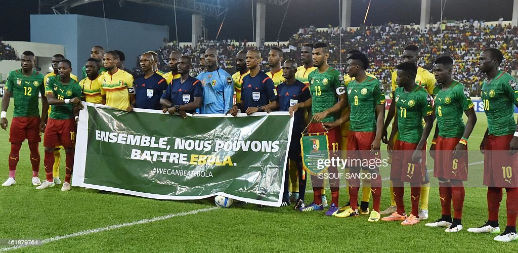 Cameroon's and Mali's players pose with a banner reading 'Together we can beat Ebola' ahead of the 2015 African Cup of Nations group D football match between Mali and Cameroon in Malabo on January 20, 2015.