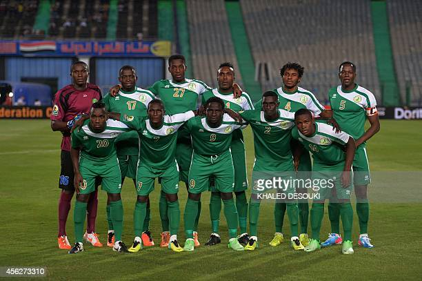 Cameroons Coton Sport club players pose for a group picture ahead of the second leg of their CAF Confederation Cup semifinal football match against...