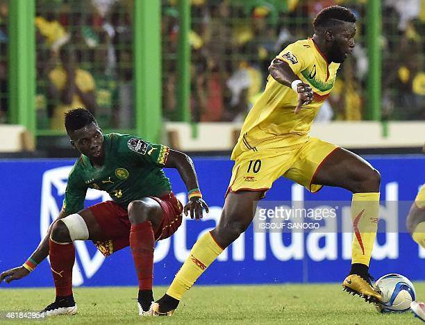 Cameroon's defender Ambroise Oyongo challenges Mali's midfielder Bakary Sako during the 2015 African Cup of Nations group D football match between...