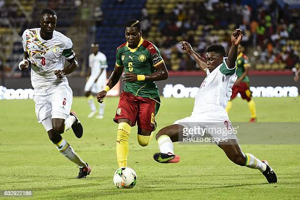 Cameroon's defender Ambroise Oyongo challenges Senegal's defenders Cheikhou Kouyate and Lamine Gassama during the 2017 Africa Cup of Nations...