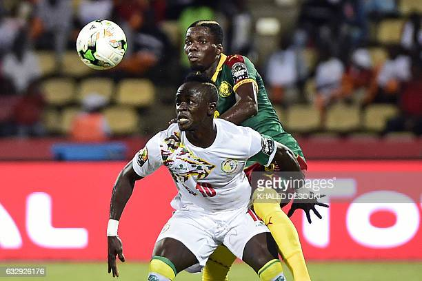 Cameroon's defender Ambroise Oyongo challenges Senegal's forward Sadio Mane during the 2017 Africa Cup of Nations quarterfinal football match between...