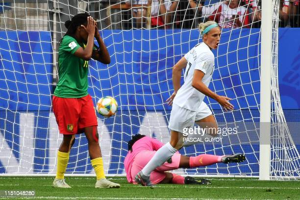 TOPSHOT Cameroon's defender Aurelle Awona reacts after scoring an own goal during the France 2019 Women's World Cup Group E football match between...