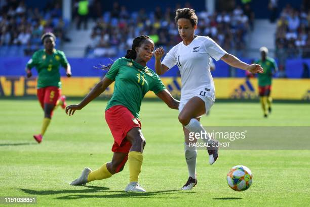 Cameroon's defender Aurelle Awona vies for the ball with New Zealand's forward Sarah Gregorius during the France 2019 Women's World Cup Group E...