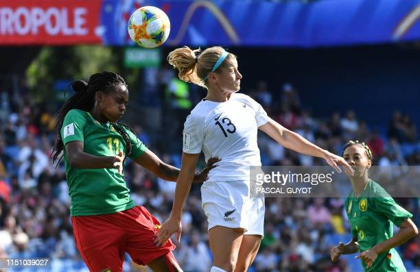 Cameroon's defender Aurelle Awona vies for the ball with New Zealand's forward Rosie White during the France 2019 Women's World Cup Group E football...