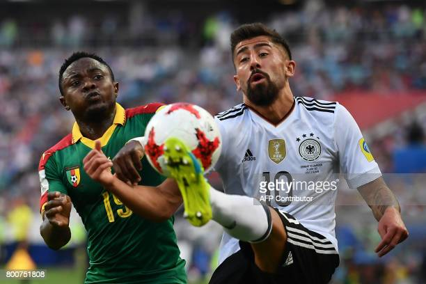 TOPSHOT Cameroon's defender Collins Fai challenges Germany's midfielder Kerem Demirbay during the 2017 FIFA Confederations Cup group B football match...