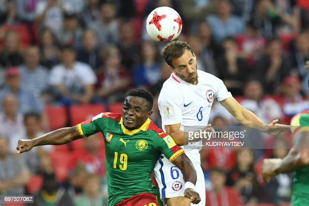 Cameroon's defender Collins Fai heads the ball with Chile's midfielder Jose Fuenzalida during the 2017 Confederations Cup group B football match...